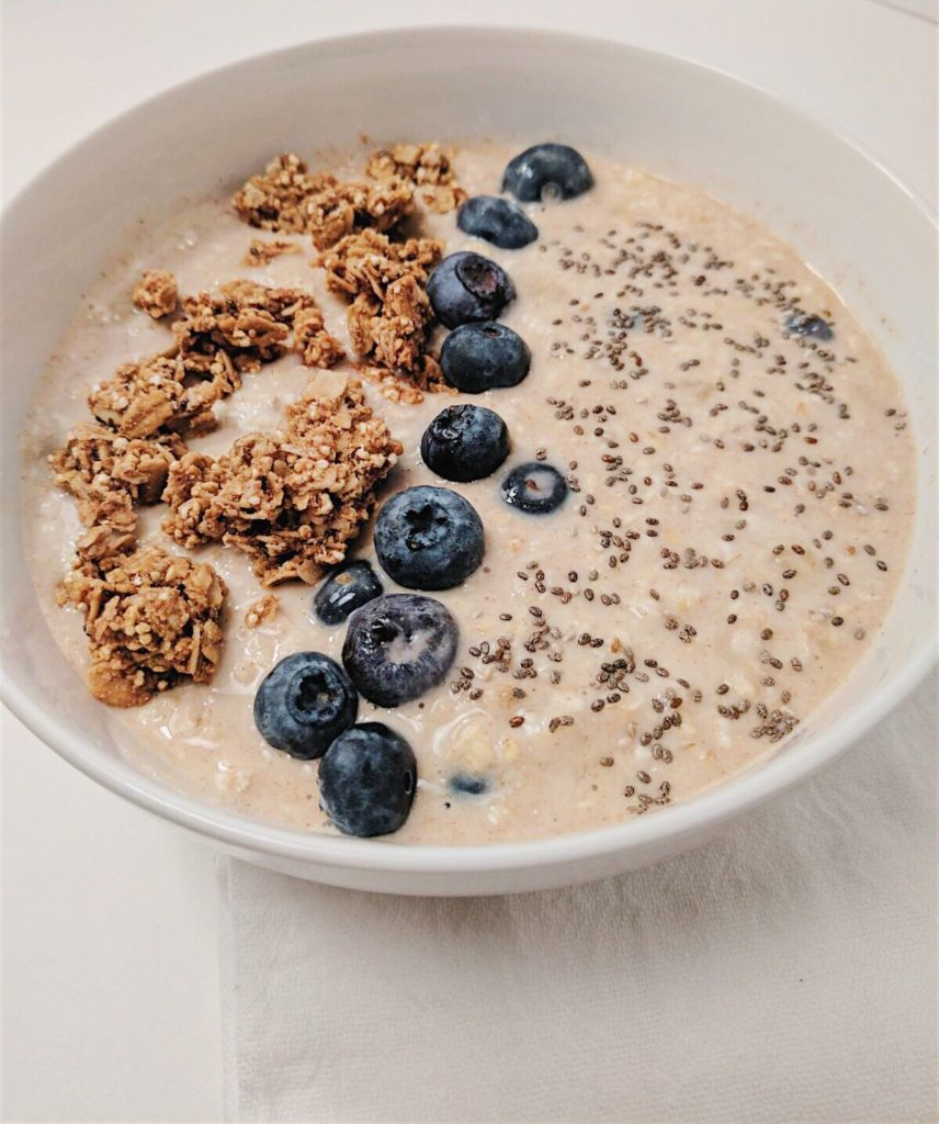 Creamy Blueberry Overnight Oats side shot in white bowl