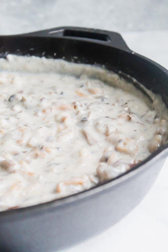 homemade cream of mushroom soup in skillet