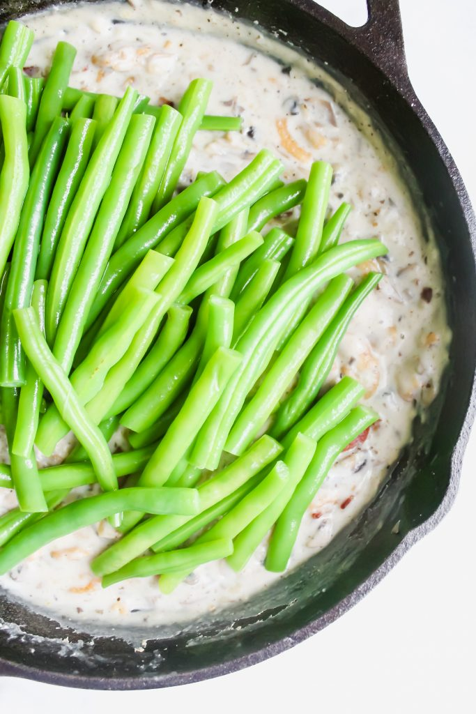 fresh blanched green beans in the mushroom soup in the skillet