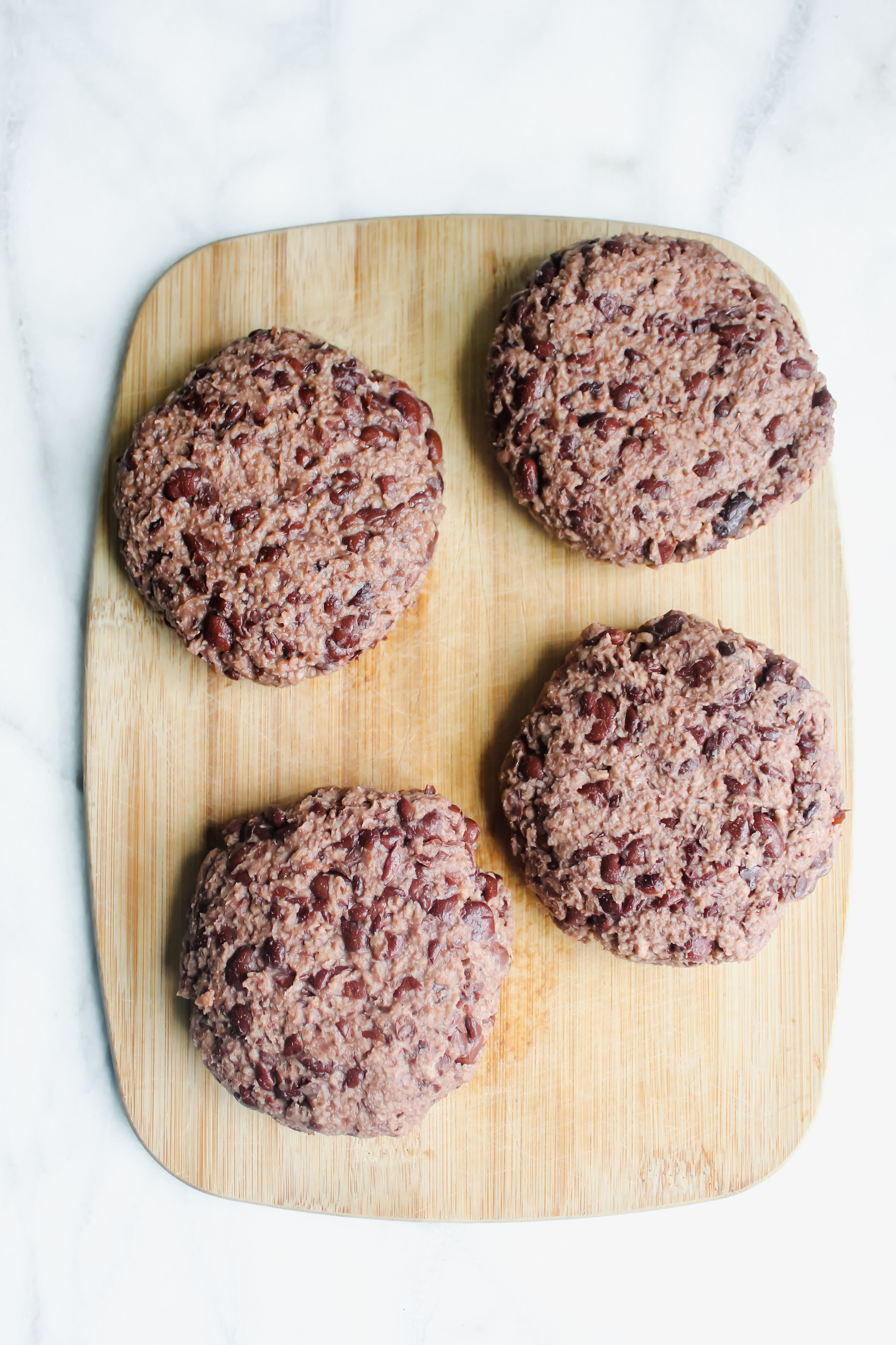 Easy Black Bean Burgers pattied into burgers pre-cook