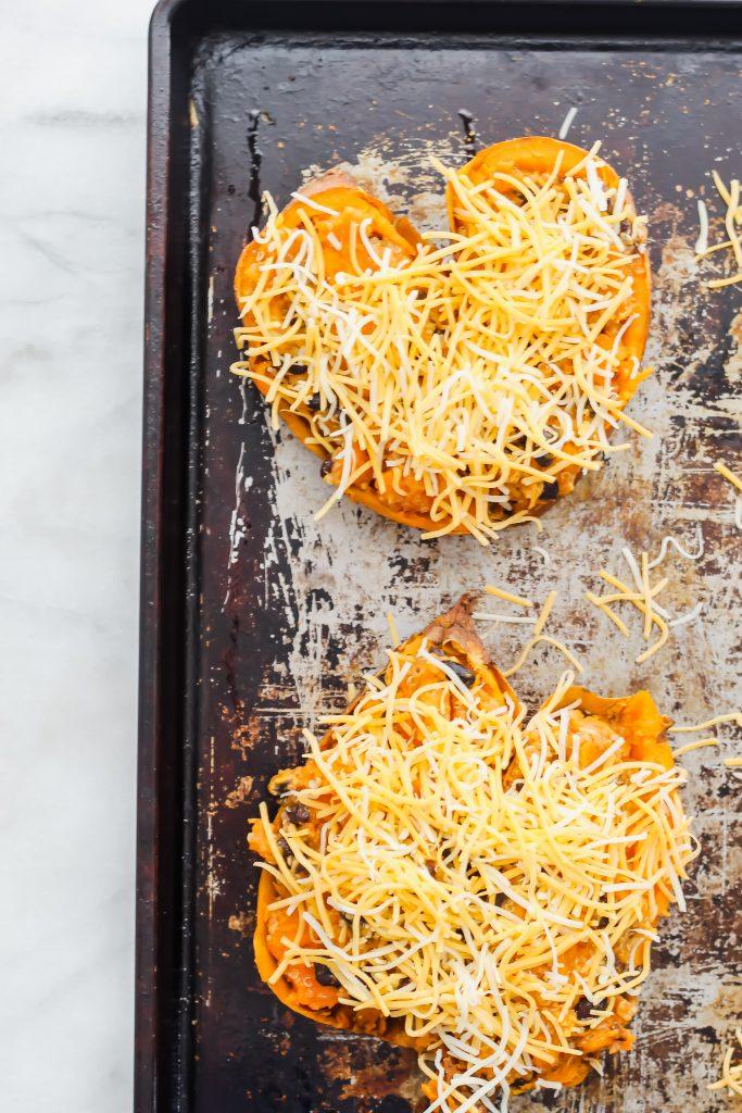 Cheesy Enchilada Stuffed Sweet Potatoes on pan