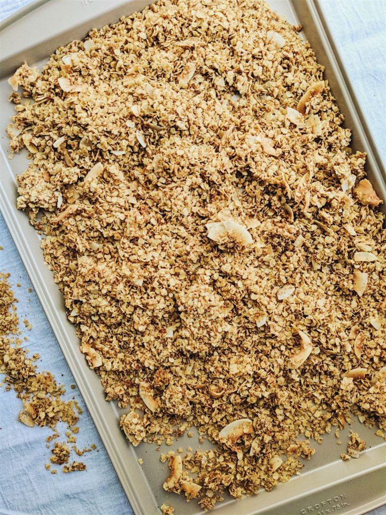 Holiday Spice Granola on gold pan full shot