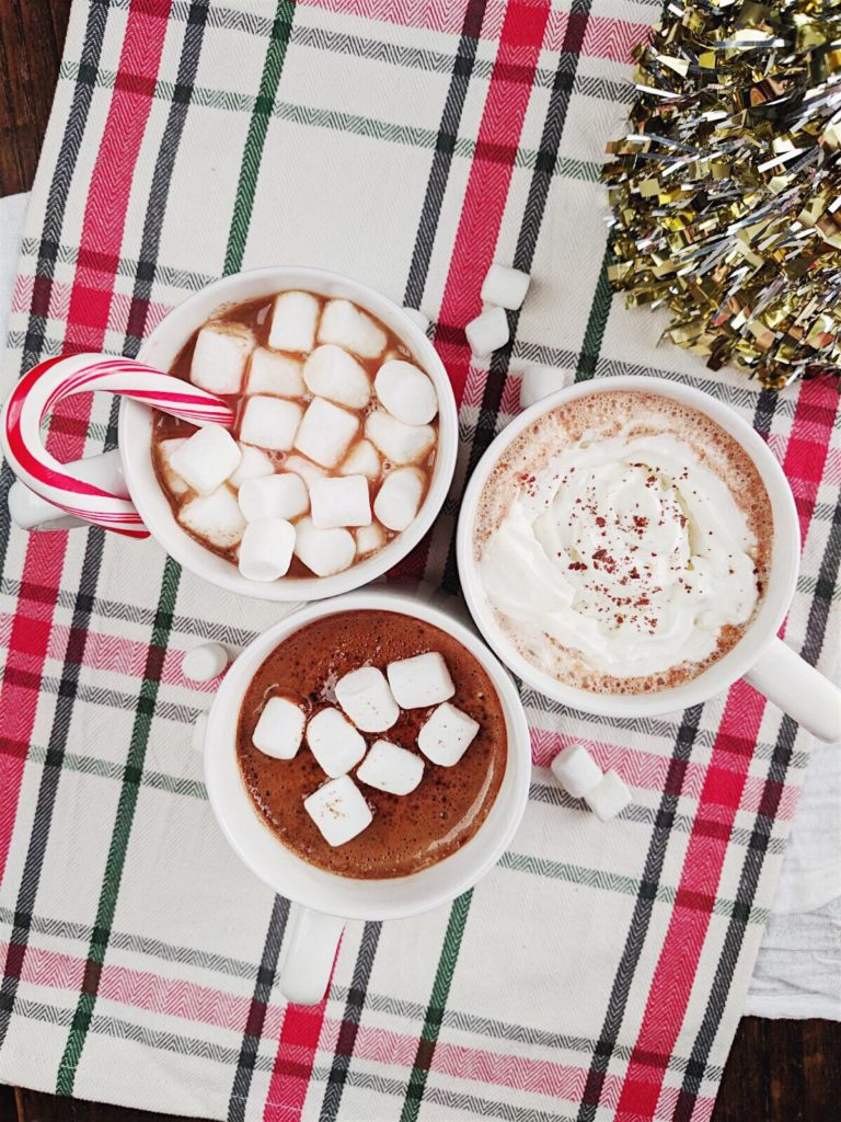 Homemade Hot Chocolate - Three Ways! with christmas tree in the background