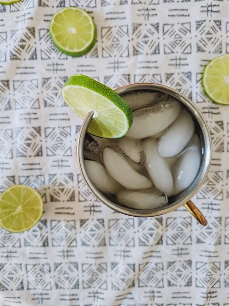 ginger kombucha moscow mules overhead shot with lime on the rim
