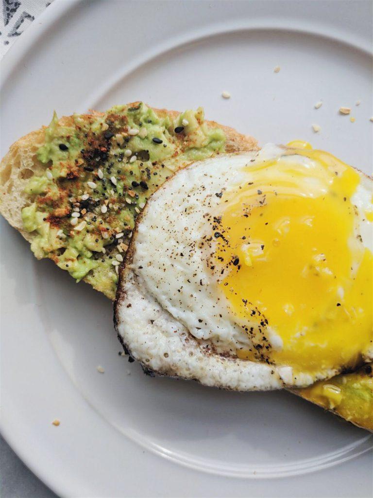everything but the bagel avocado toast close up yolk shot
