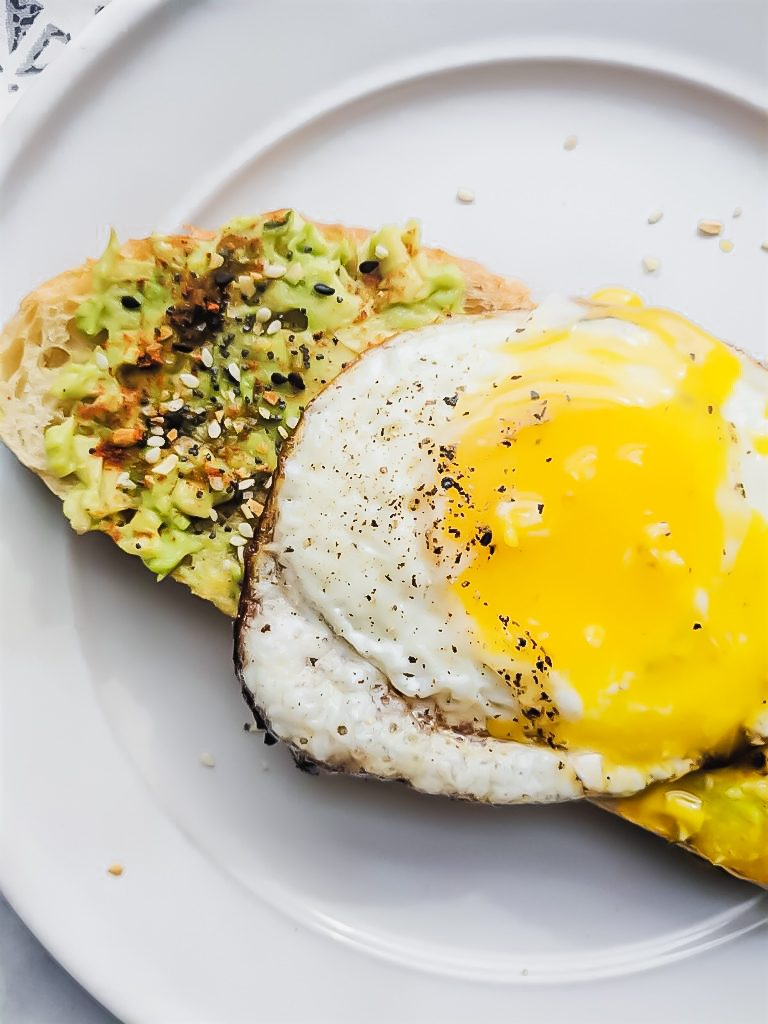 close up of runny egg and Everything but the Bagel Avocado Toast