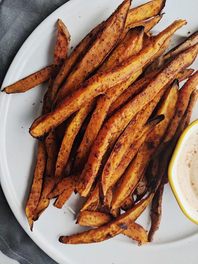 crispy cajun sweet potato fries close up shot on plate