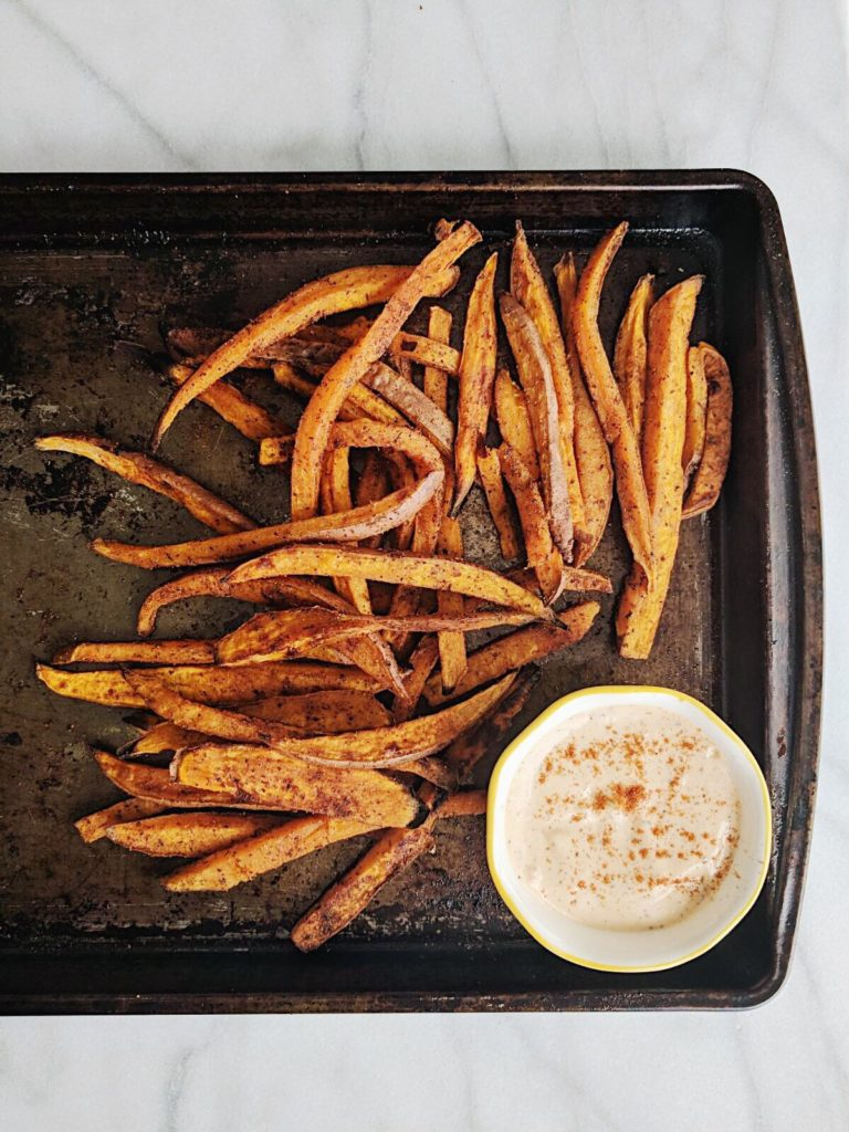 crispy cajun sweet potato fries on pan