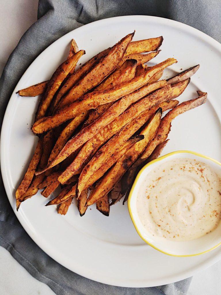 crispy cajun sweet potato fries far away on plate