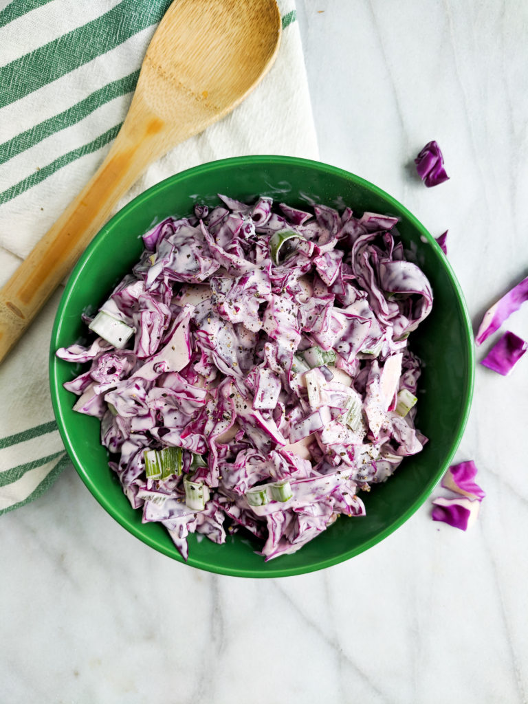 creamy coleslaw with red cabbage and green onions