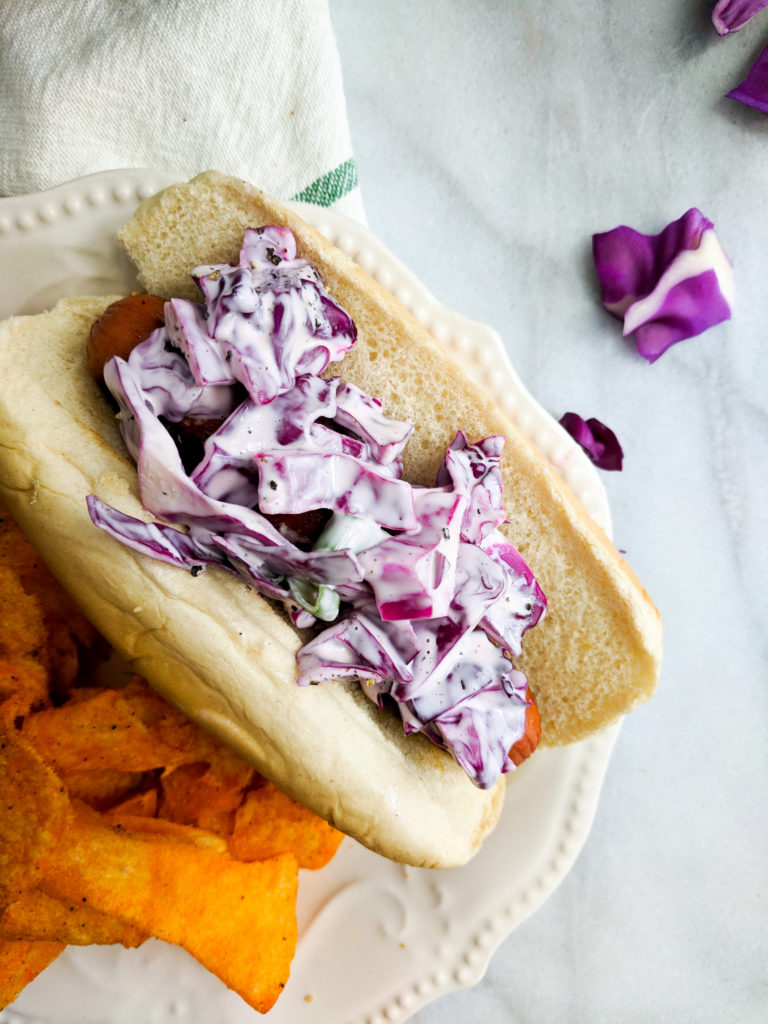 quick and easy creamy coleslaw on a hot dog