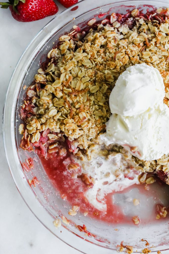 overhead view of Strawberry Coconut Crisp with melted ice cream