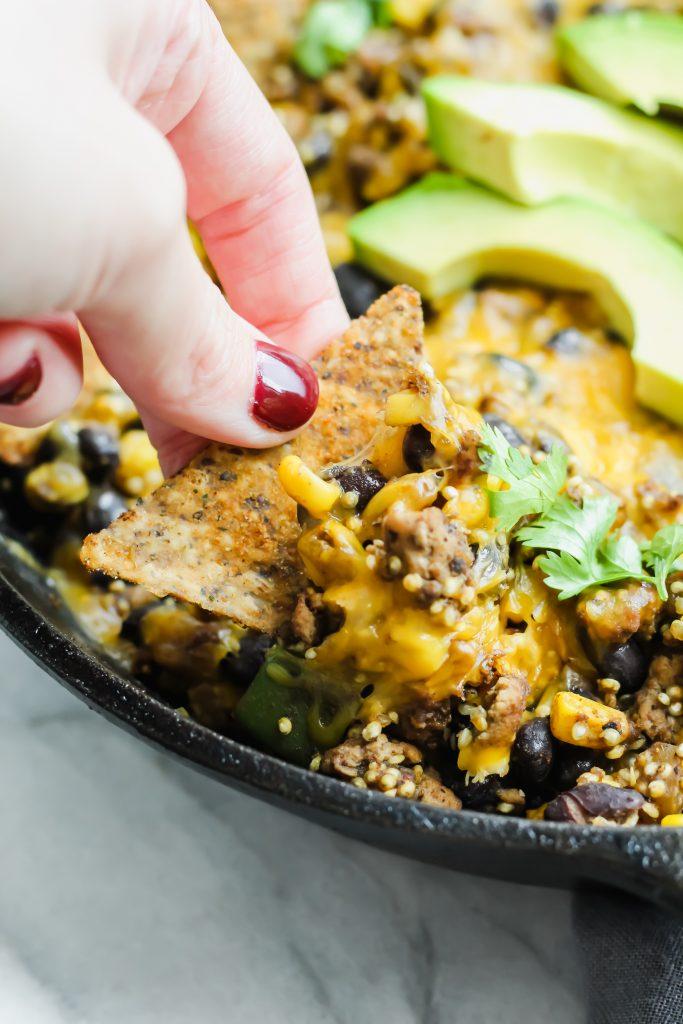 dipping chip in Turkey Taco Quinoa Skillet