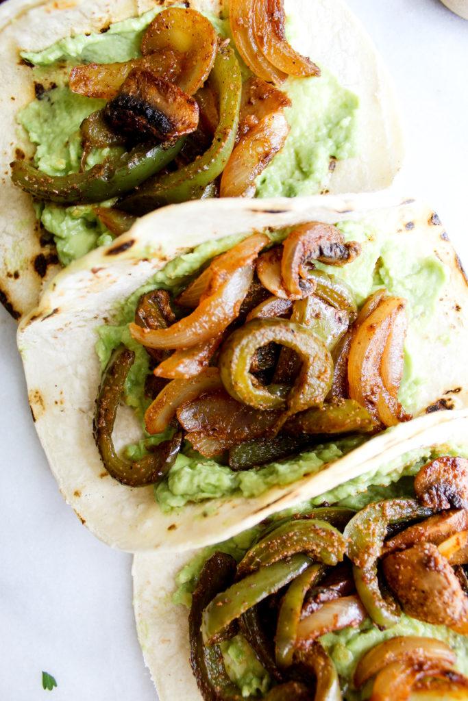 Spicy Breakfast Fajita Tacos close up of creamy guacamole and fajita veggies