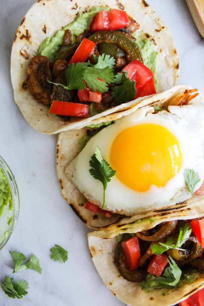 Spicy Breakfast Fajita Tacos close up of the fried egg and cilantro