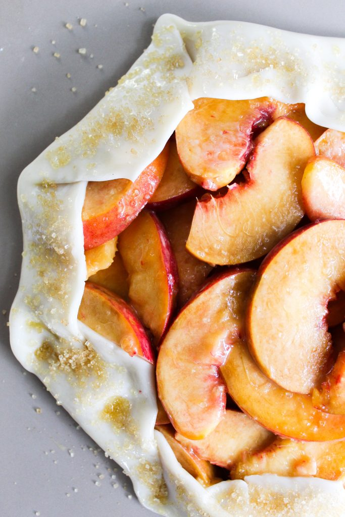 Rustic Honey Peach Galette with egg wash and turbinado sugar