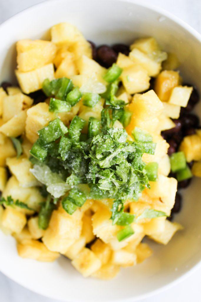 cilantro and salt garnish on pineapple black bean salsa