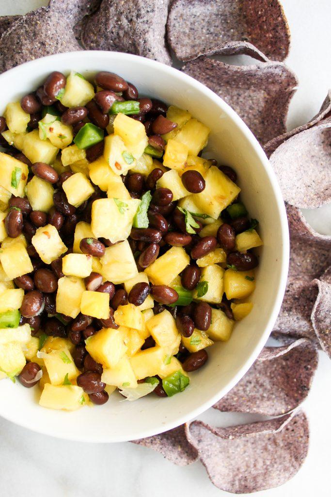 easy Pineapple Black Bean Salsa with blue corn tortilla chips
