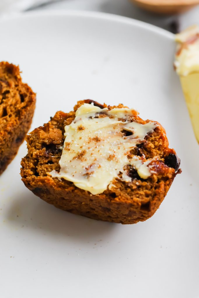 Healthier Pumpkin Chocolate Chip Muffin with butter on plate