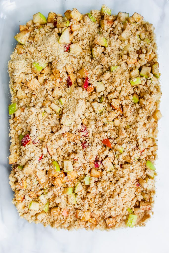 Apple Crumble Bars with Cinnamon Spice Glaze crust with apple mixture