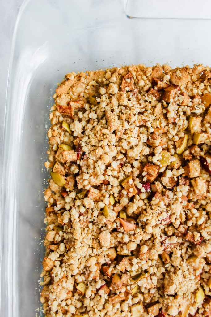 Apple Crumble Bars with Cinnamon Spice Glaze in glass baking dish