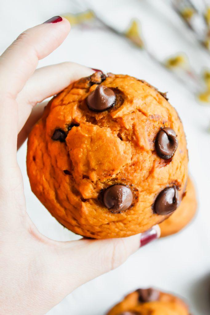 Healthier Pumpkin Chocolate Chip Muffins in my hand