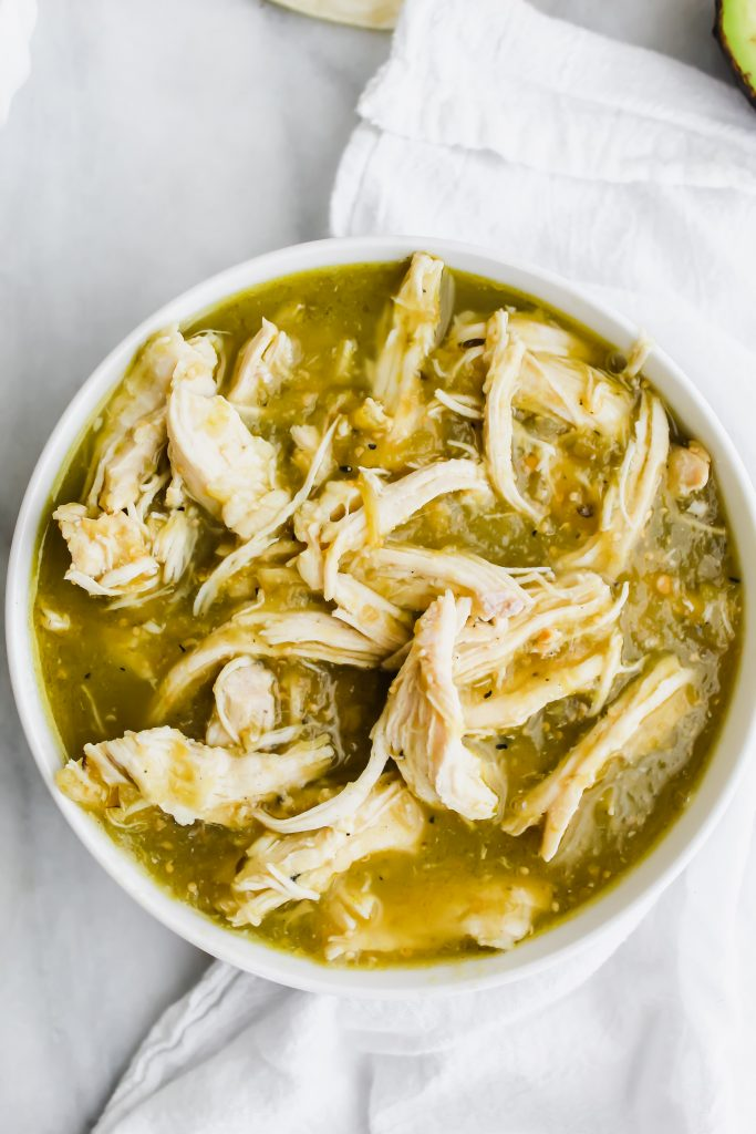 big white bowl of 2 ingredient salsa verde chicken