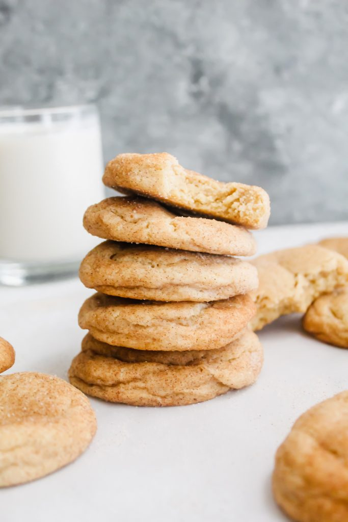 stack of Soft Chai Snickerdoodles with top cookie with a bite taken out of it
