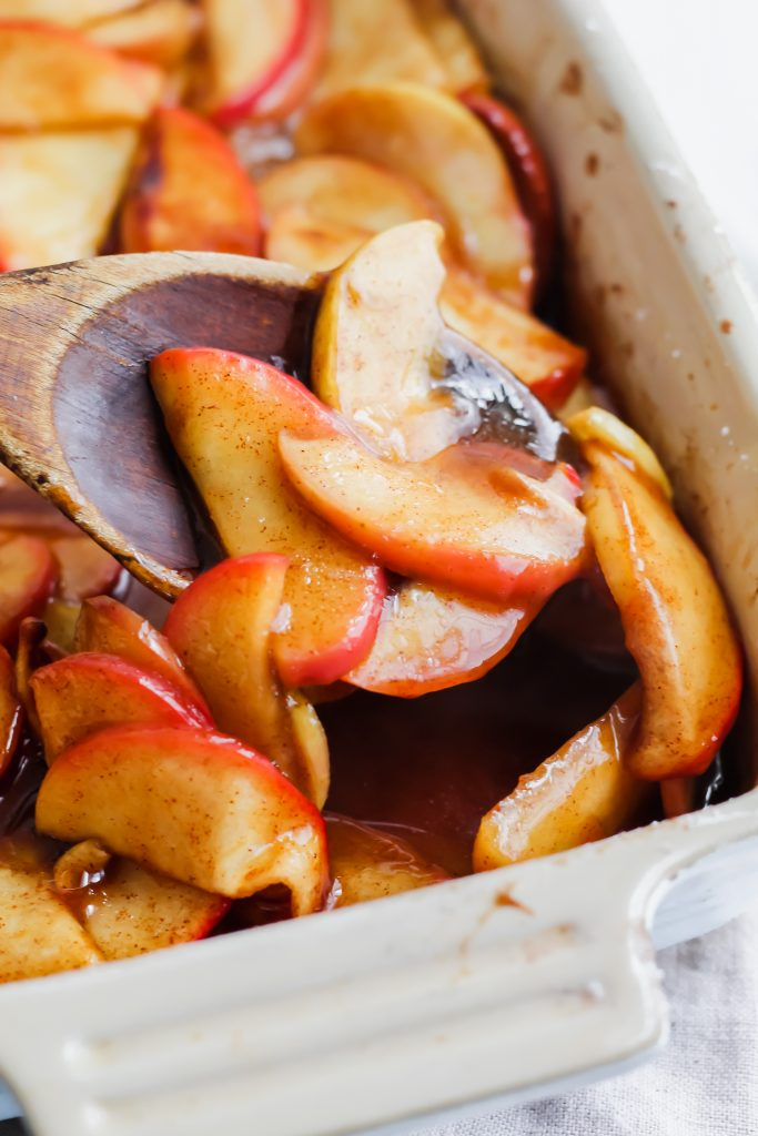 wooden spoon full of Cinnamon Spice Baked Apples