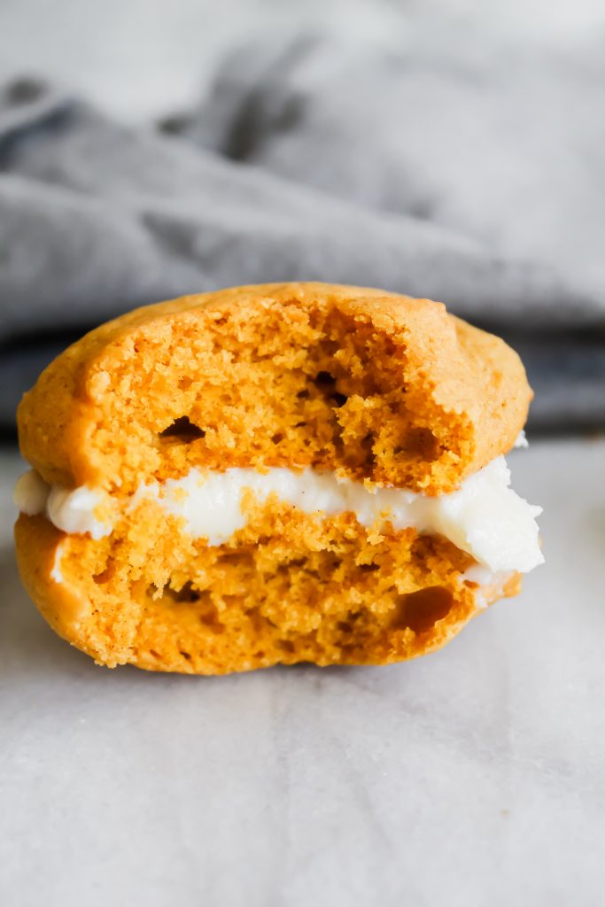 close up of bite taken out of a pumpkin spice whoopie pie