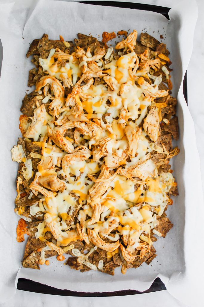 loaded baked chicken nachos with melted cheese