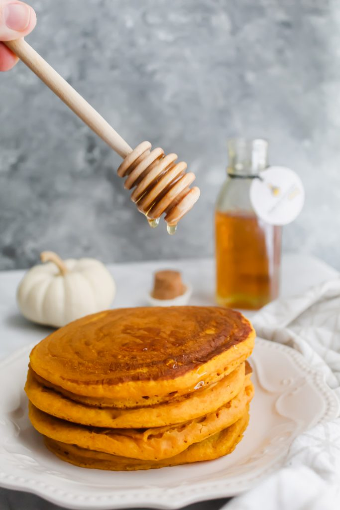 honey drizzle on Honey Maple Pumpkin Pancakes