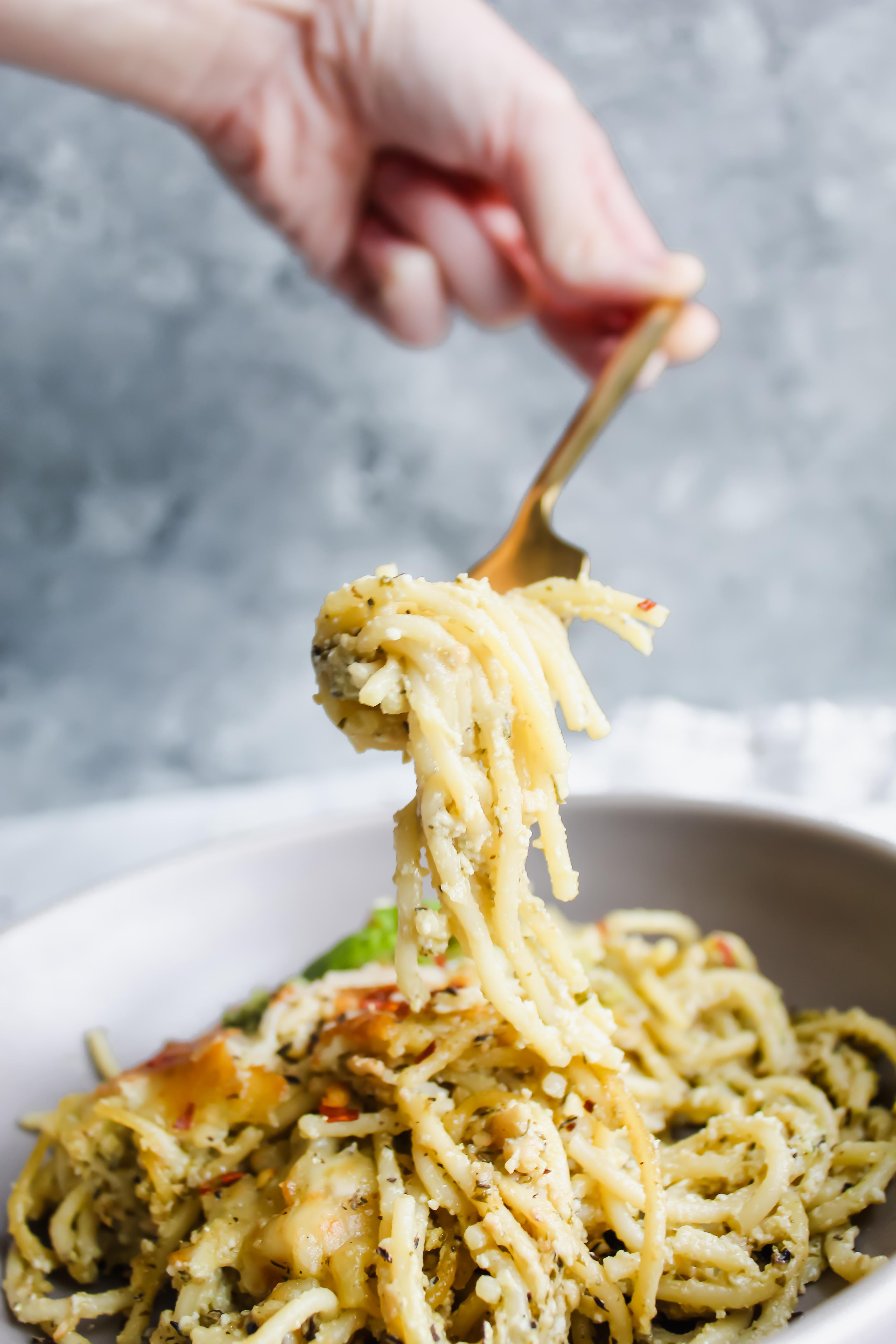 Cheesy Pesto Spaghetti Pie noodle twirl in gray bowl