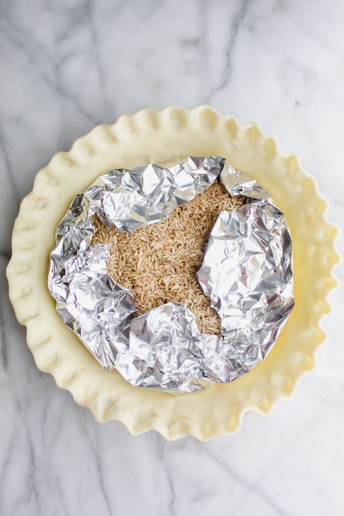 weighed down middle of the pie crust with aluminum foil and dried rice