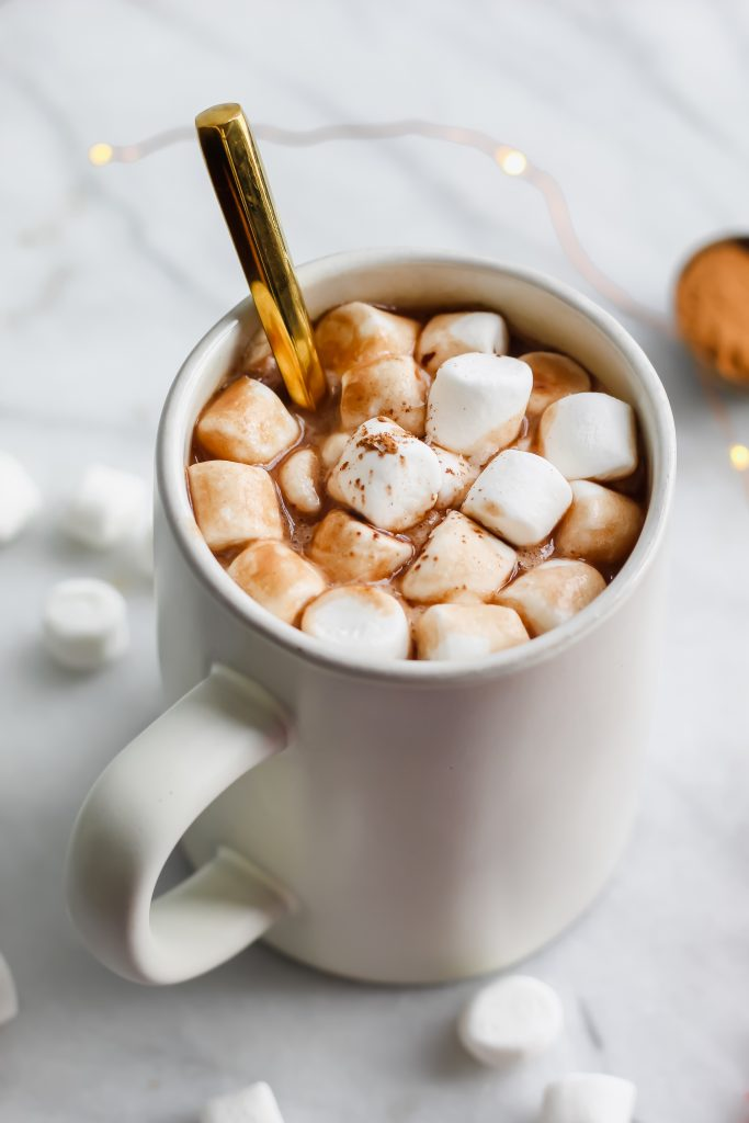 Coconut Hot Chocolate with golden spoon