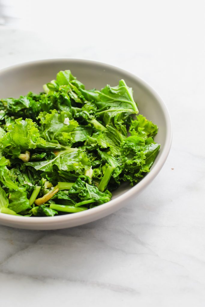 sauteed wilted greens in grey bowl