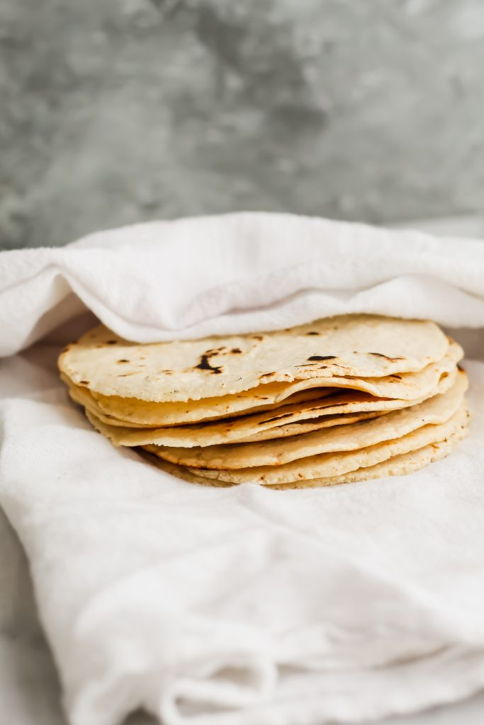 homemade corn tortillas wrapped in a towel