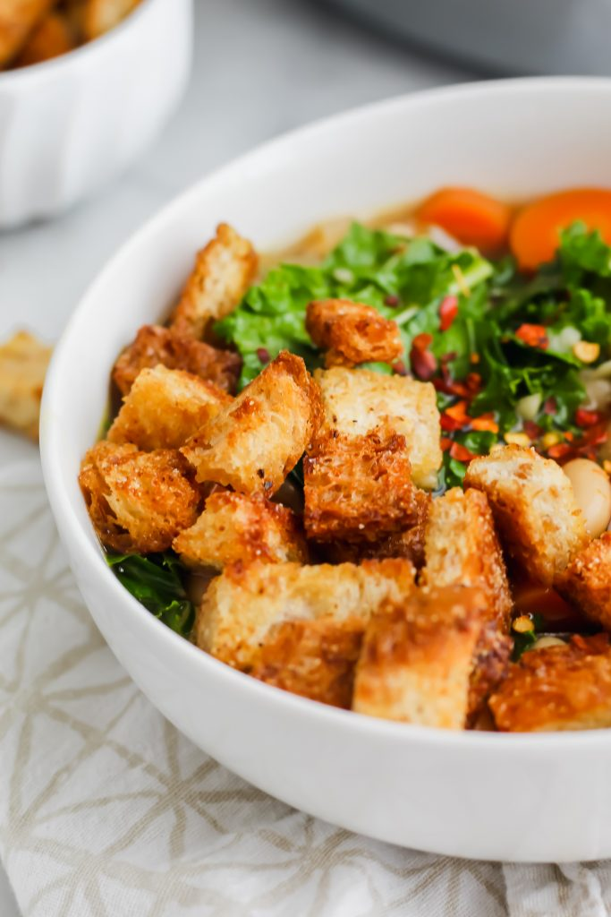 close up of golden brown and crunchy garlic bread croutons