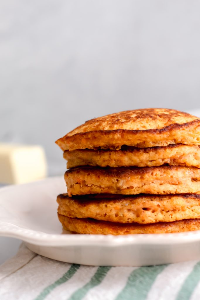 freshly cooked Carrot Cake Pancakes on white plate
