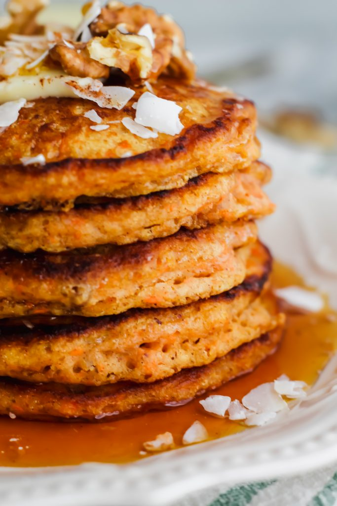 close up of Carrot Cake Pancakes with maple syrup