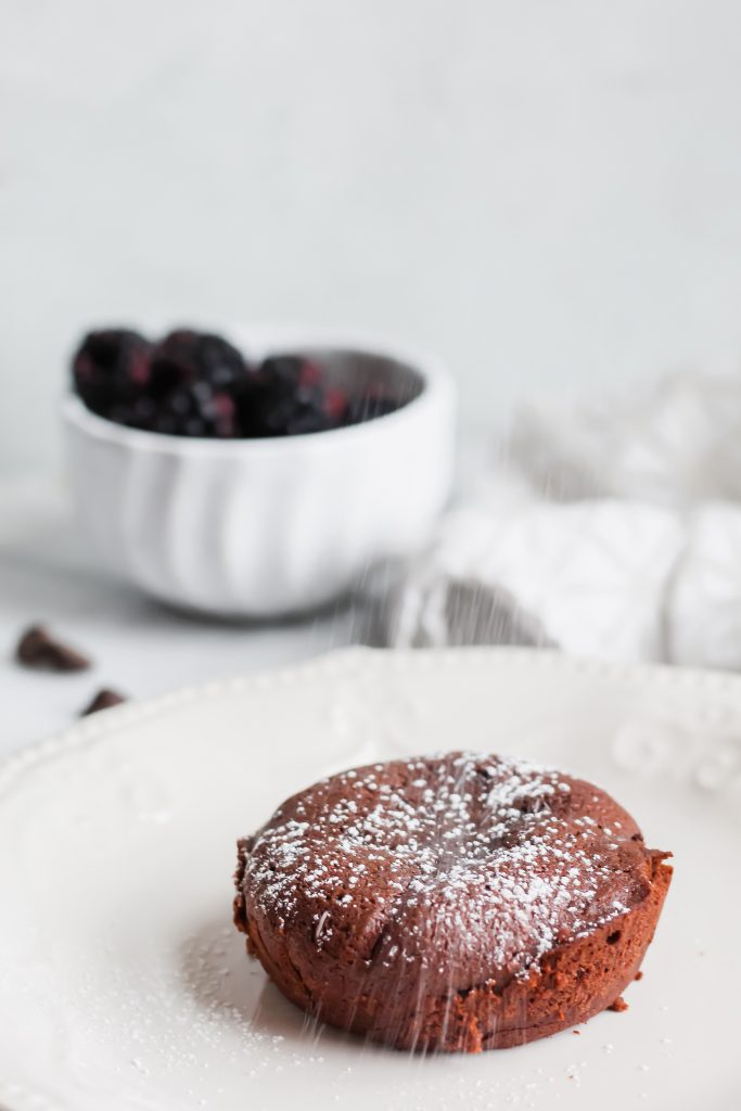 Dark Chocolate Lava Cake with powdered sugar being dusted on top