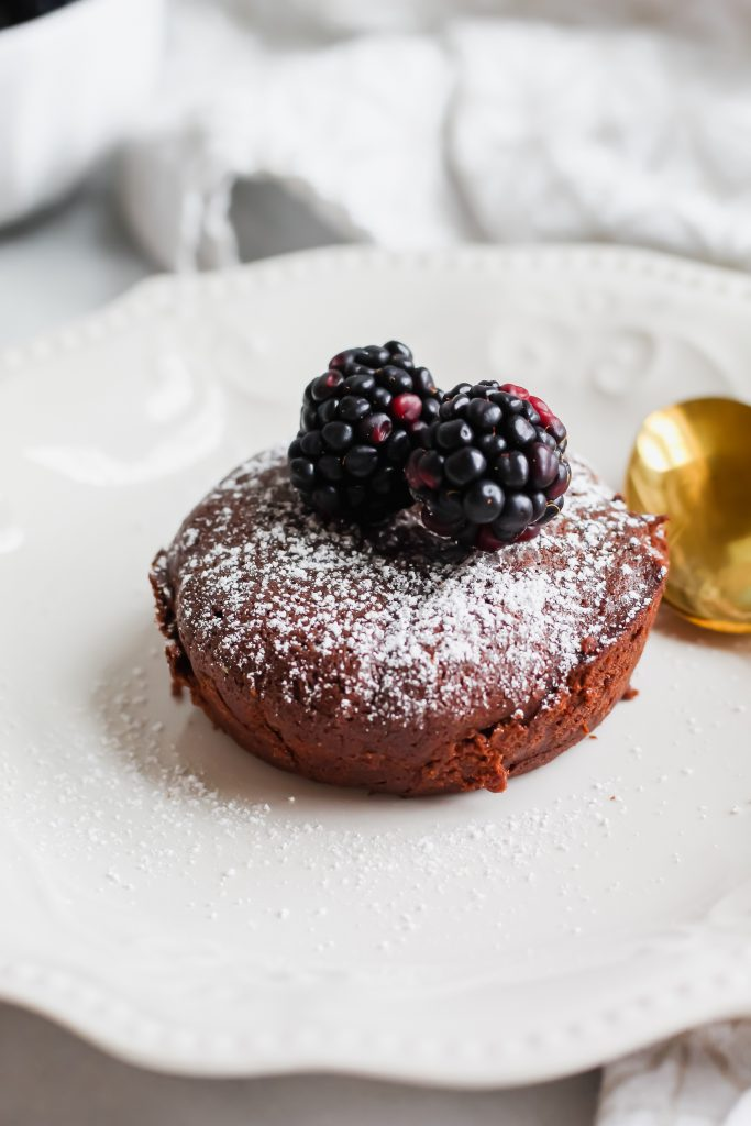 perfectly baked Dark Chocolate Lava Cake with blackberries and powdered sugar