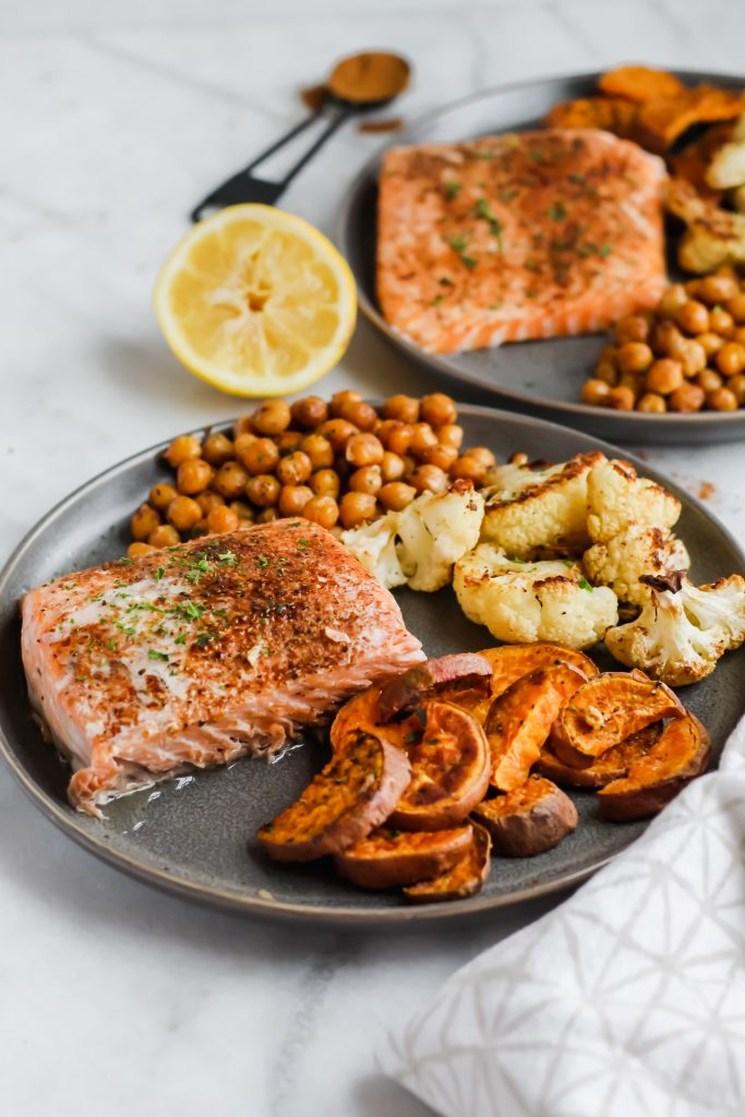 full plate at side angle of sheet pan moroccan salmon dinner