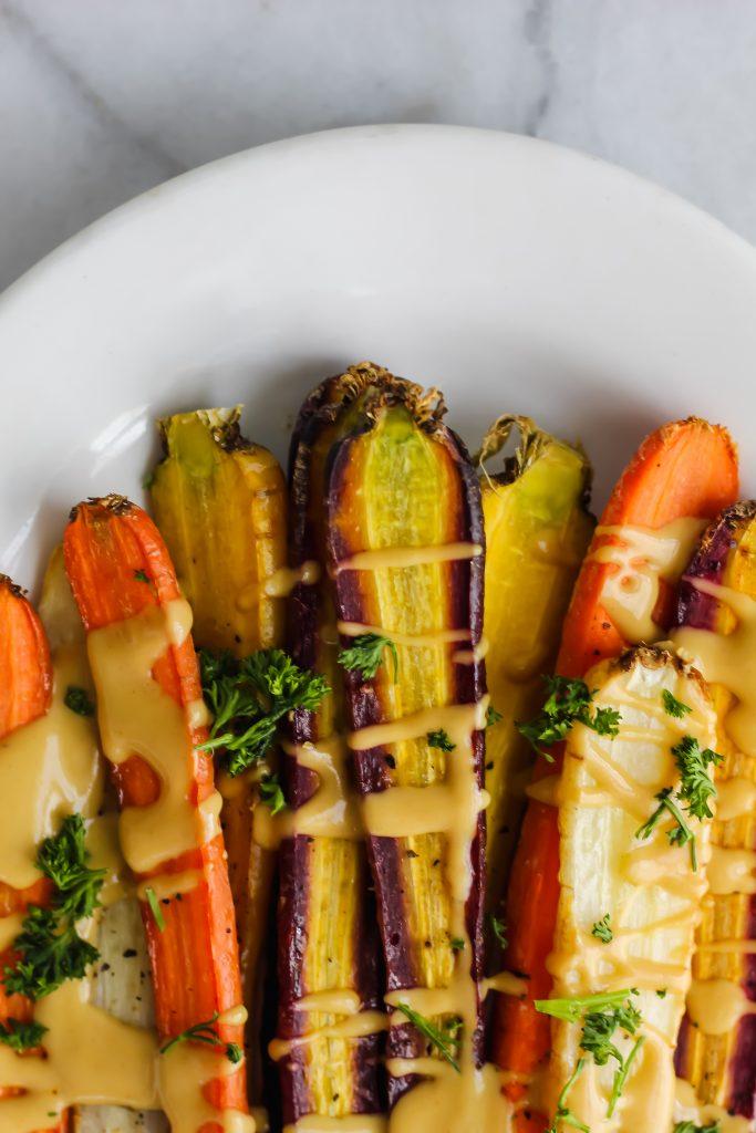 tops of roasted rainbow carrots on tray