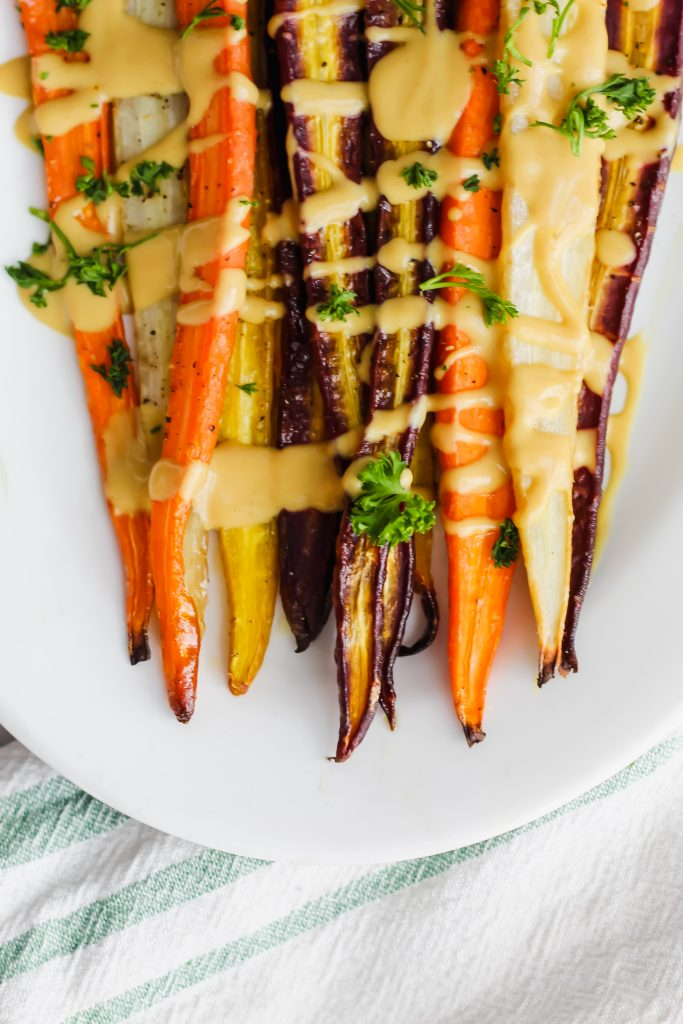 bottoms of roasted rainbow carrots on tray
