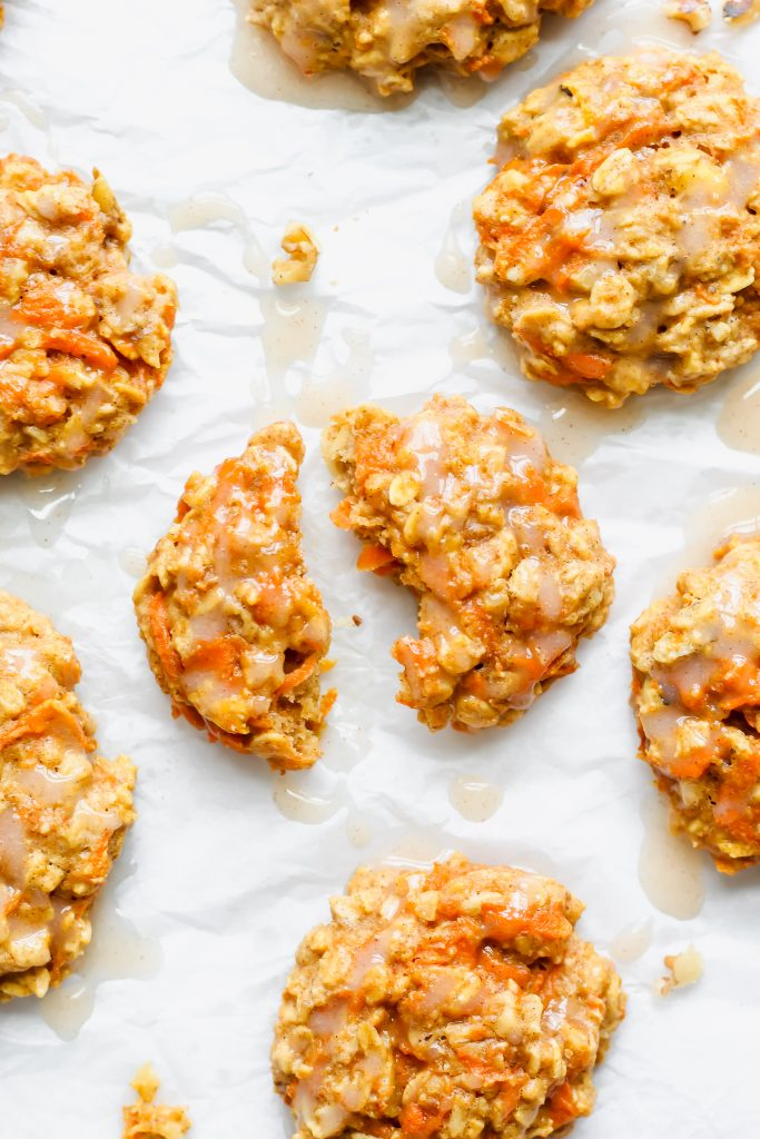 Carrot Cake Breakfast Cookie in half with cinnamon icing glaze