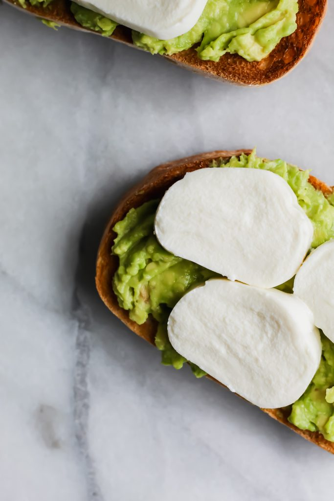 sliced fresh mozzarella on avocado toast