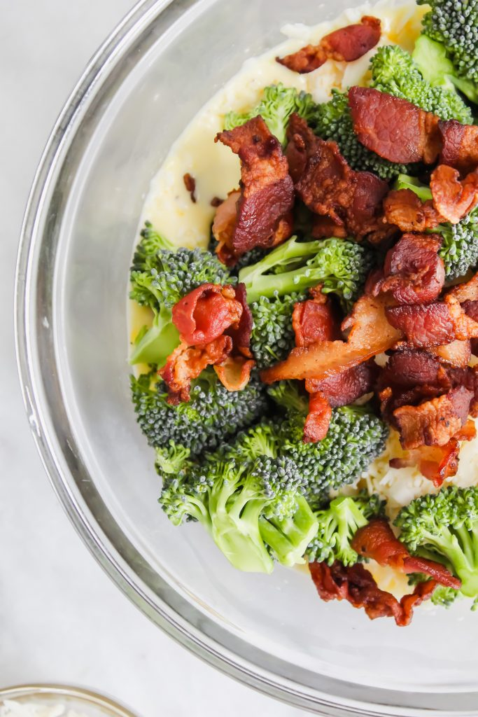 bacon, broccoli, cheese, eggs and cream in bowl