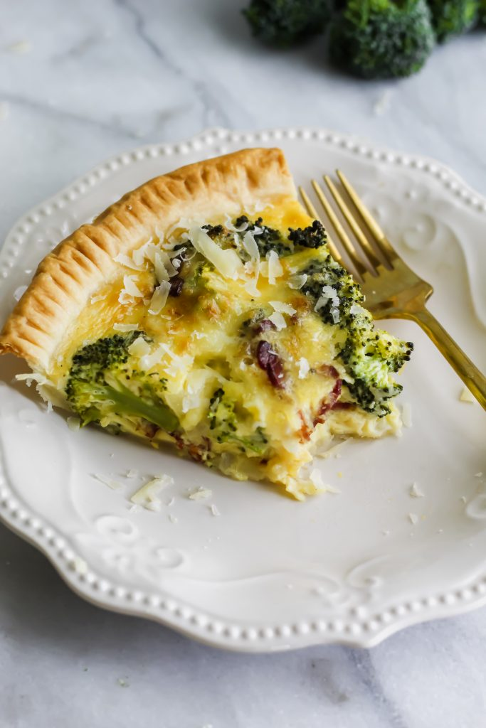 side view of Broccoli Cheddar Quiche with Bacon and fork