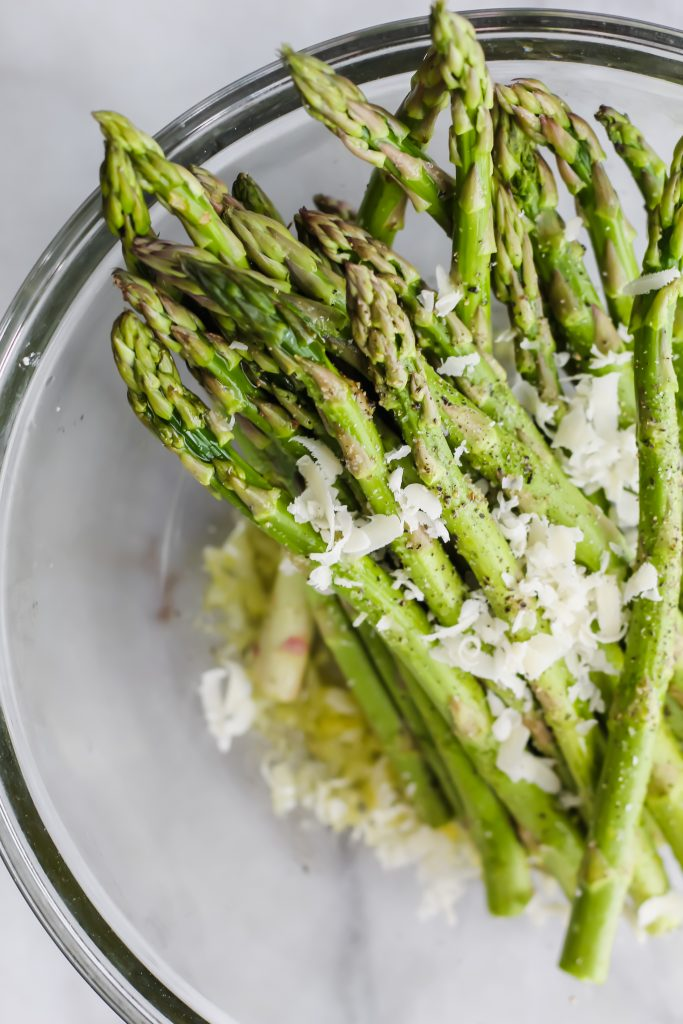 glass bowl of asparagus and parmesan cheese